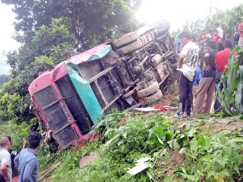 The wreckage of passenger bus (Ba 2 Kha 6817) that skidded off the road at Budhathoki Gaun, in Changunarayan of Bhaktapur district, on Tuesday, July 26, 2016. Photo: RSS