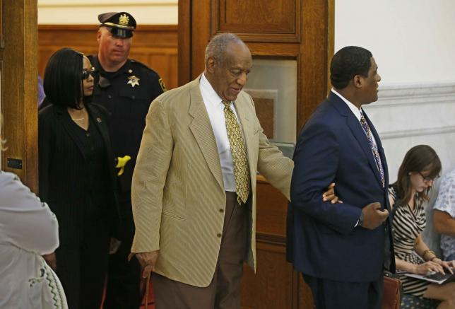 Bill Cosby (C) is led out of Courtroom A of the Montgomery County Courthouse in Philadelphia, Pennsylvania, U.S. July 7, 2016.  REUTERS/Michael Bryant/Pool