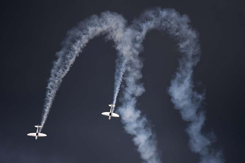 The Twisters display team perform at the Farnborough International Airshow in Hampshire on Saturday, July 16, 2016. The airshow is a weeklong event, combining trade exhibitions and public airshows. Photo: AP