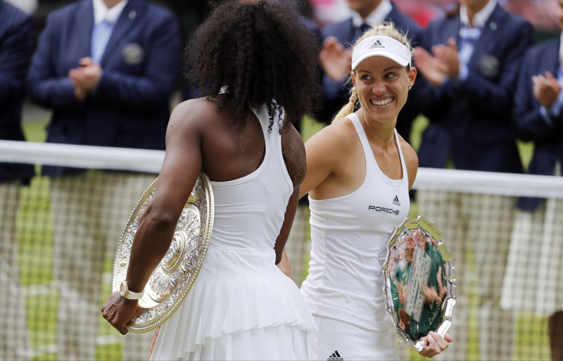 Serena Williams of the US left, shakes hands with Angelique Kerber of Germany after beating her in the women's singles final on day thirteen of the Wimbledon Tennis Championships in London, on Saturday, July 9, 2016. Photo: AP