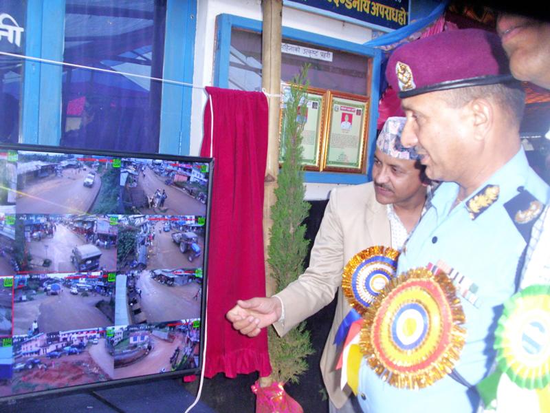 Biratnagar-based Eastern Regional Police Office Chief Keshari Raj Ghimire inaugurates the newly installed CCTV camera in Phidim, district headquarters of Panchthar, on Sunday, July 10, 2016. Photo: Laxmi Gautam
