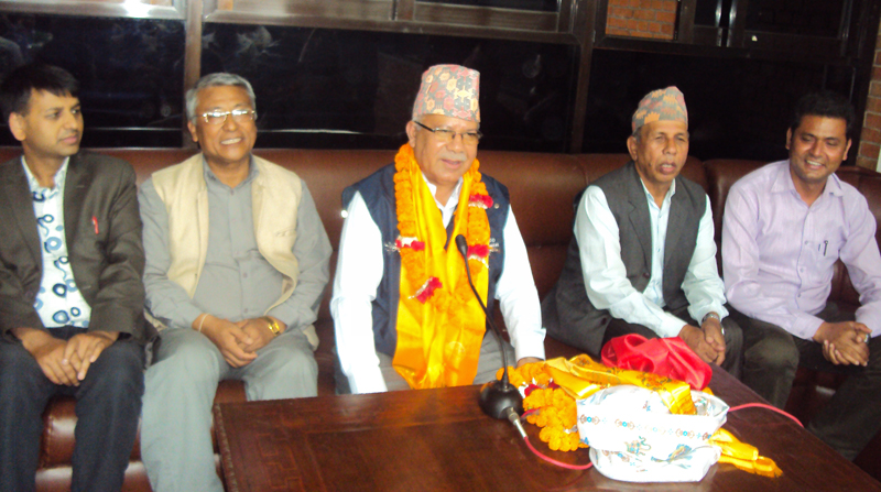 CPN-UML leader Madhav Kumar Nepal (centre) speaks with journalists at the Tribhuvan International Airport, on Wednesday, July 6, 2016. Photo: RSS