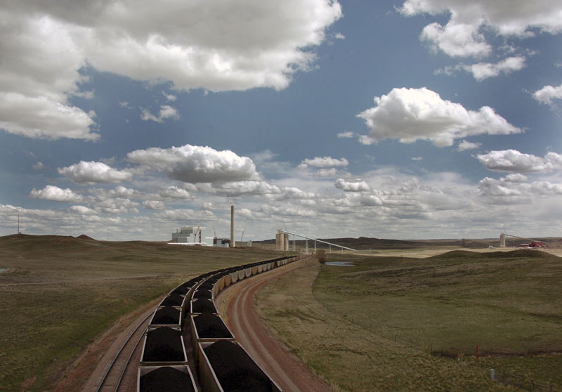 FILE - A pair of coal trains idle on the tracks near Dry Fork Station, a coal-fired power plant being built by the Basin Electric Power Cooperative near Gillette, Wyoming, on Thursday, April 29, 2010. Photo: AP