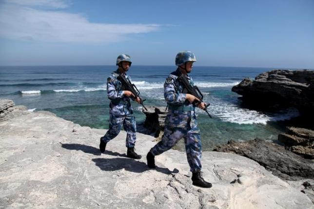 Soldiers of China's People's Liberation Army (PLA) Navy patrol on Woody Island, in the Paracel Archipelago, which is known in China as Xisha Islands, January 29, 2016. Picture taken January 29, 2016. REUTERS/Stringer/Files