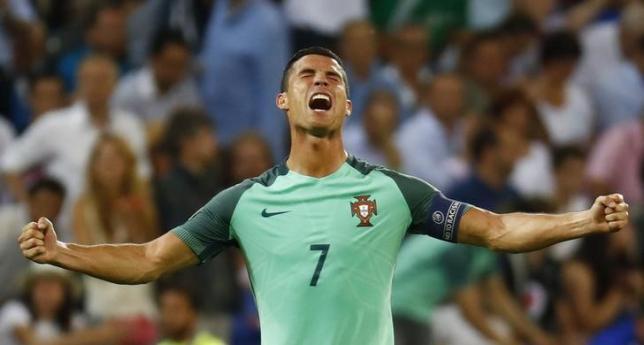 Football Soccer - Portugal v Wales - EURO 2016 - Semi Final - Stade de Lyon, Lyon, France - 6/7/16nPortugal's Cristiano Ronaldo celebrates at the end of the match nREUTERS/Kai PfaffenbachnLivepic