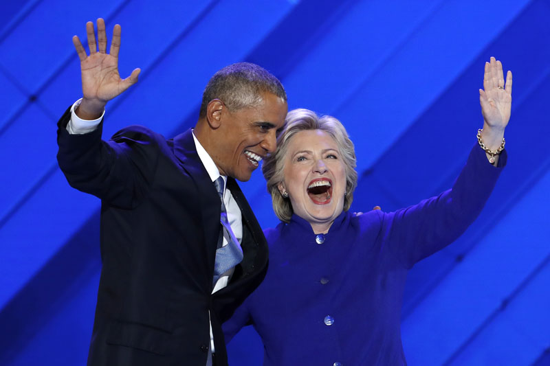 President Barack Obama and Democratic Presidential nominee Hillary Clinton wave to delegates after President Obama's speech during the third day of the Democratic National Convention in Philadelphia, on Wednesday, July 27, 2016. Photo: AP