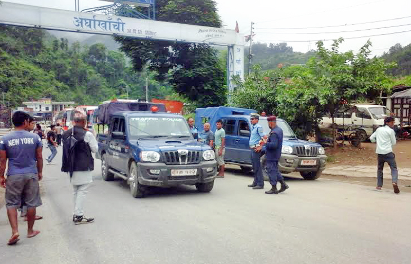 Police escorting vehicles during the nationwide bandh called by CPN Maoist along Prithvi Highway road section in Galchi,  Dhading, on Monday, July 25, 2016. Photo: THT