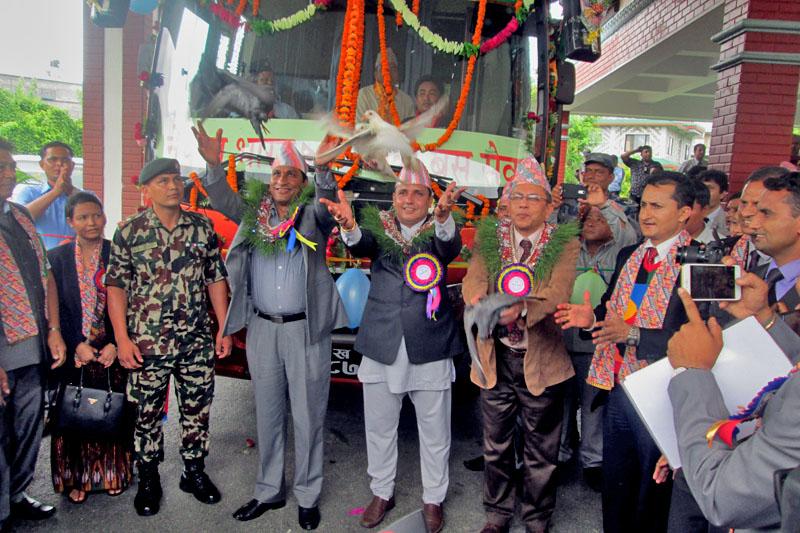 Nepalu2019s Home Minister Shakti Bahdur Basnet and Indian Ambassador to Nepal Ranjit Rae launch a direct bus service from Pokhara to Delhi on July 11, 2016 on Monday. Photo: Rishi Ram Baral