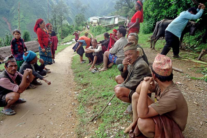 Displaced locals of Phopli village wait for relief from the government in Pyuthan district, on Thursday, July 28, 2016. Photo: THT