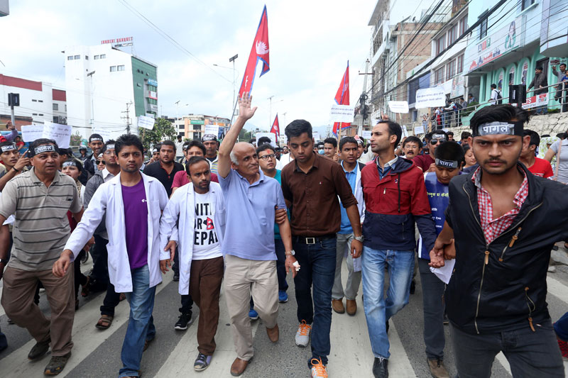 Veteran orthopaedic surgeon Dr Govinda KC (centre) takes part in a rally with his supporters demanding reforms in the medical education sector in New Baneshwor, on Saturday, July 30, 2016. Photo: RSS