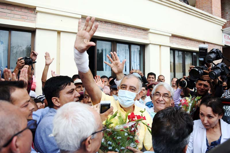 Dr Shashanka Koirala, General Secretary of the Nepali Congress, waves to the camera after getting discharged from the Om Hospital, in Kathmandu, on July 20, 2016. Photo: RSS