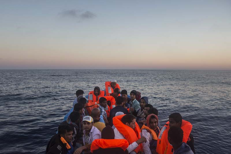 File- Refugees and migrants overcrowd a wooden boat during a rescue operation on the Mediterranean sea, about 19 miles north of Az Zawiyah, Libya, on July 21, 2016. Photo: AP
