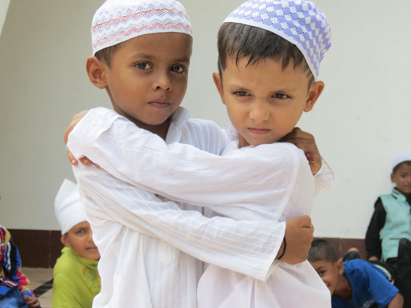 Muslim children of Islamic community hug each other during Eid al-Fitr celebrations, which marks the end of the Muslim fasting month of Ramadan, in Rautahat district, on July, 7, 2016. Photo: Prabhat Kumar Jha