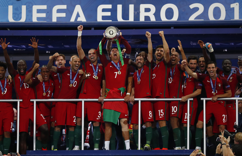 Portugal's Cristiano Ronaldo celebrates with team mates and the trophy after winning Euro 2016 at Stade de France, in Paris, on Sunday, July 10, 2016. Photo: Reuters
