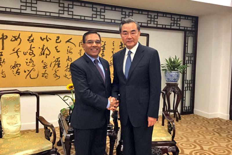 (Left) Nepal's Foreign Secretary Shanker Das Bairagi shakes hands with Chinese Minister of Foreign Affairs Wang Yi at the Ministry of Foreign Affairs in Beijing on Monday, July 4, 2016. Photo Courtesy: Embassy of Nepal, Beijing