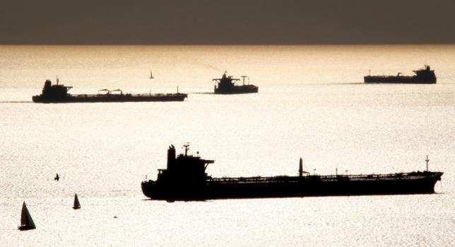 Oil and gas tankers are anchored off the Marseille harbour, southeastern France, October 27, 2010.  REUTERS/Jean-Paul Pelissier/File Photo