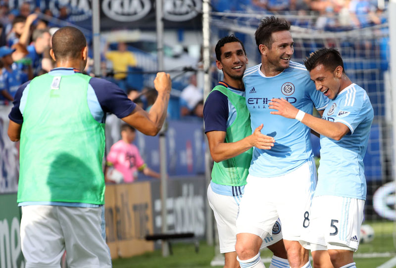 New York City FC midfielder Frank Lampard (8) celebrates his goal against Montreal Impact with teammates during the second half at Stade Saputo on July 17, 2016. Mandatory Credit: Jean-Yves Ahern-USA TODAY Sports