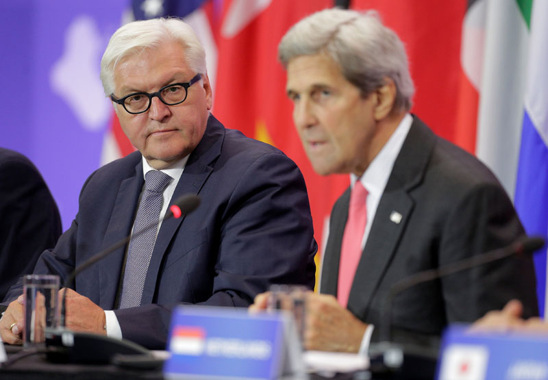 German Foreign Minister Frank-Walter Steinmeier (L) listens as US Secretary of State John Kerry speaks during a Pledging Conference in Support of Iraq, co-hosted by the United States, Canada, Germany, Japan, Kuwait, and The Netherlands at the State Department in Washington, US, on July 20, 2016. Photo: REUTERS