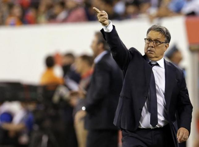 Jun 26, 2016; East Rutherford, NJ, USA; Argentina manager Gerardo Martino directs his team against Chile during the second half in the championship match of the 2016 Copa America Centenario soccer tournament at MetLife Stadium. Mandatory Credit: Adam Hunger-USA TODAY Sports