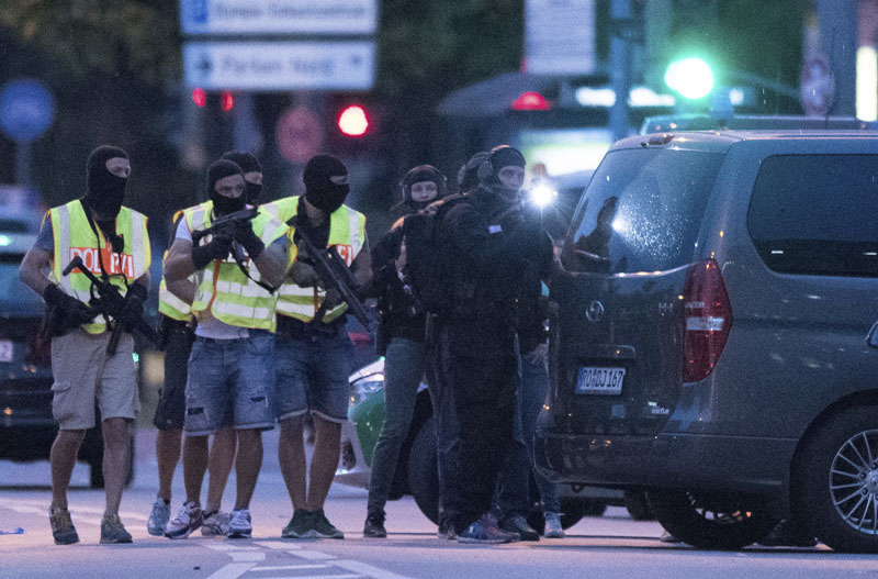 Special police forces prepare to search a neighbouring shopping centre outside the Olympia mall in Munich, southern Germany, on Friday, July 22, 2016 after several people have been killed in a shooting. Photo: AP