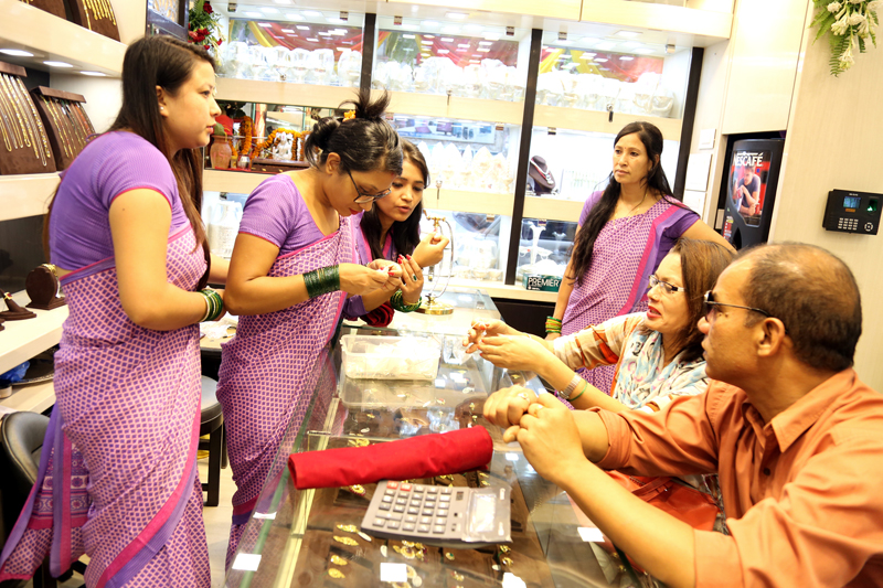 FILE: Customers buy gold ornaments at a jewellery shop in New Road, on Thursday, July 28, 2016. Photo: RSS