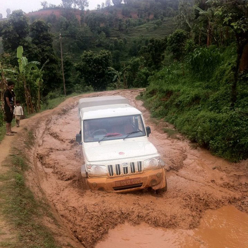 A jeep is trapped in mud along the Gorkha-Arughat road in Gorkha district, on Saturday, July 30, 2016. The road which was blacktopped four years ago at the cost of Rs 140 million has turned muddy and disrupted the transportation in the region. Photo: RSS