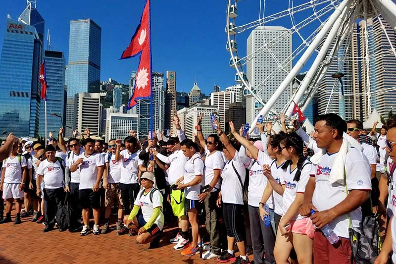 Hikers pose for a photograph during the 'Hike for Nepal in Hong Kong' event in front of the Observation Wheel in Hong Kong's Central District on July 24, 2016. Courtesy: Arendra Gurung