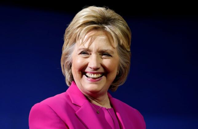 Hillary Clinton smiles during a campaign rally, where she received the endorsement of Barack Obama, in Charlotte, North Carolina, July 5, 2016. REUTERS/Jonathan Ernst