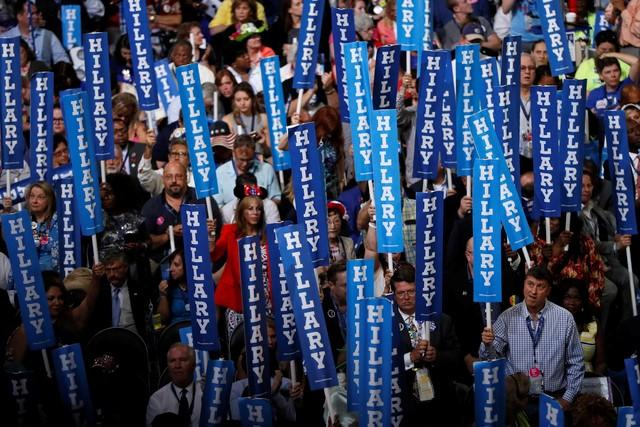 Delegates hold Hillary signs. REUTERS/Rick Wilking.