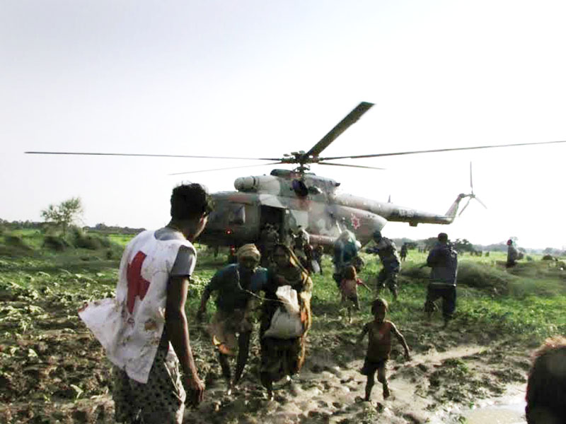 Flood victims being rescued by NA helicopter at Holiya VDC, in Banke, on Wednesday, July 27, 2016. Photo: THT