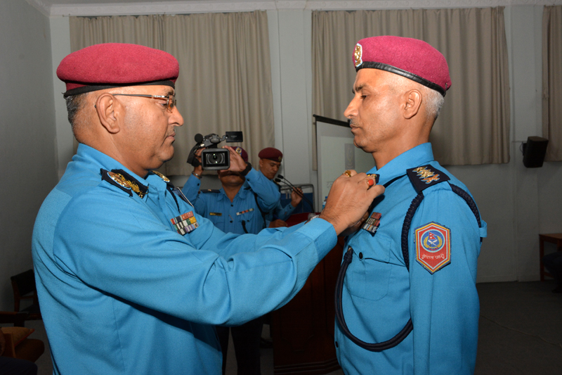 IGP Upendra Kant Aryal conferring insignia on an SSP, in Kathmandu, on Sunday, July 17, 2016. Photo: Nepal Police
