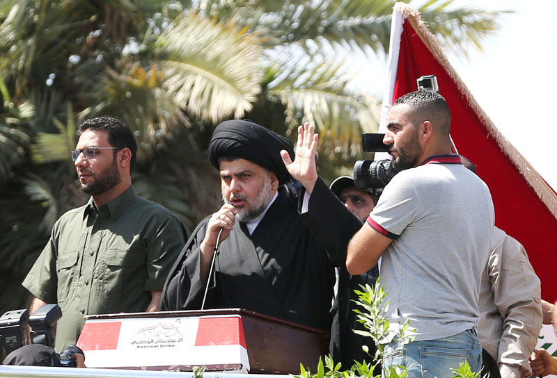 Iraq's Shiite cleric Muqtada al-Sadr (centre), speaks to his followers demonstrating at Tahrir Square in Baghdad, Iraq, on Friday, July 15, 2016. Photo: AP