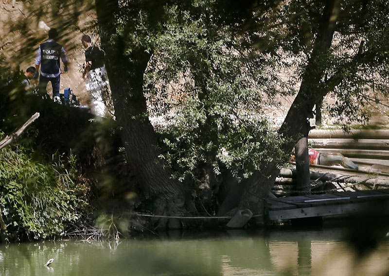 The body of a young man, right, lies on the banks of the Tiber river in Rome, Monday, July 4, 2016. Photo: AP/File