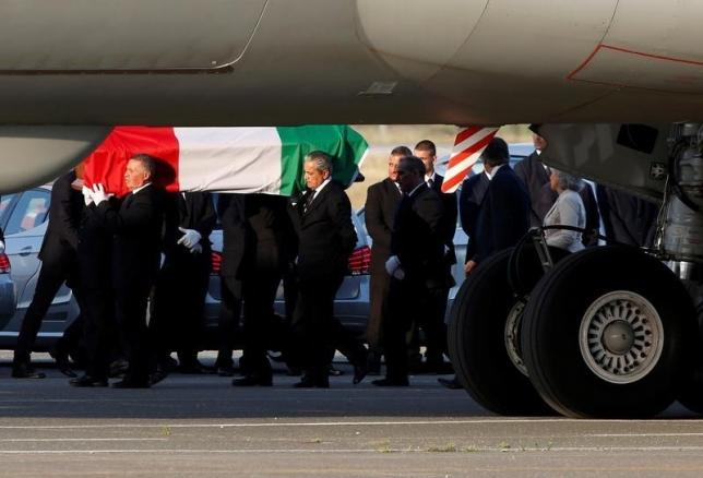 A coffin containing the body of one of the nine Italians killed in the Bangladesh attack is carried by pallbearers as it is disembarked from an Italian airplane at Ciampino military airbase, south of Rome, Italy, July 5, 2016. REUTERS/Remo Casilli