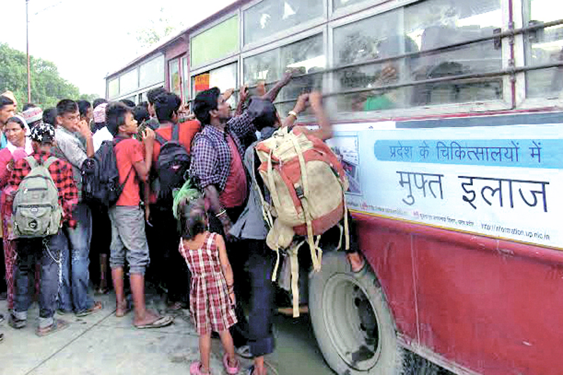 People trying to board a bus to India, in Jajarkot, on Friday, July 22, 2016. Locals have been leaving for India in search of jobs following a prolonged drought. Photo: THT