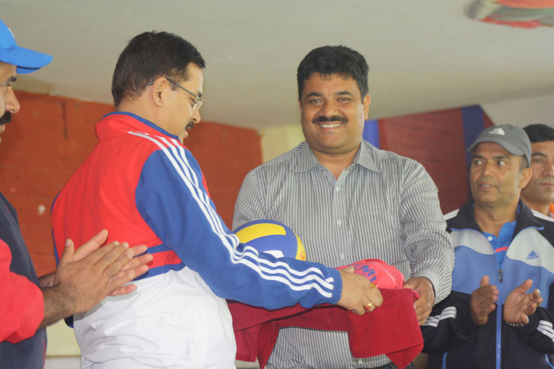 Janapremi College of Bhaktapur distributs volleyball gears to the womenu2019s team of Nepal Police Club at the Nepal Police Training Academy on Thursday, June 30, 2016. Photo: THT
