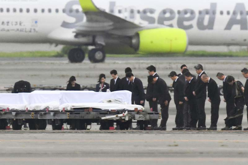 The coffins of the victims who were killed in the last weekend's attack on a restaurant in Bangladesh, arrive at Haneda Airport in Tokyo, Tuesday, July 5, 2016. The bodies of the Japanese victims arrived Tuesday morning in Tokyo on a Japanese government airplane. Photo: AP