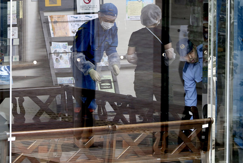 Police investigators check the Tsukui Yamayuri-en, a facility for the mentally disabled where a number of people were killed and dozens injured in a knife attack in Sagamihara, outside Tokyo, on Tuesday, July 26, 2016. Photo: AP