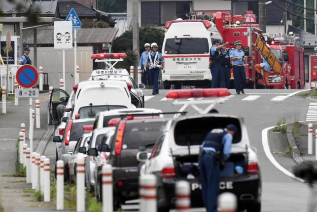 Police officers are seen near a facility for the disabled where at least 19 people were killed and as many as 20 wounded by a knife-wielding man, in Sagamihara, Kanagawa prefecture, Japan, in this photo taken by Kyodo July 26, 2016. Mandatory credit Kyodo/via REUTERS.
