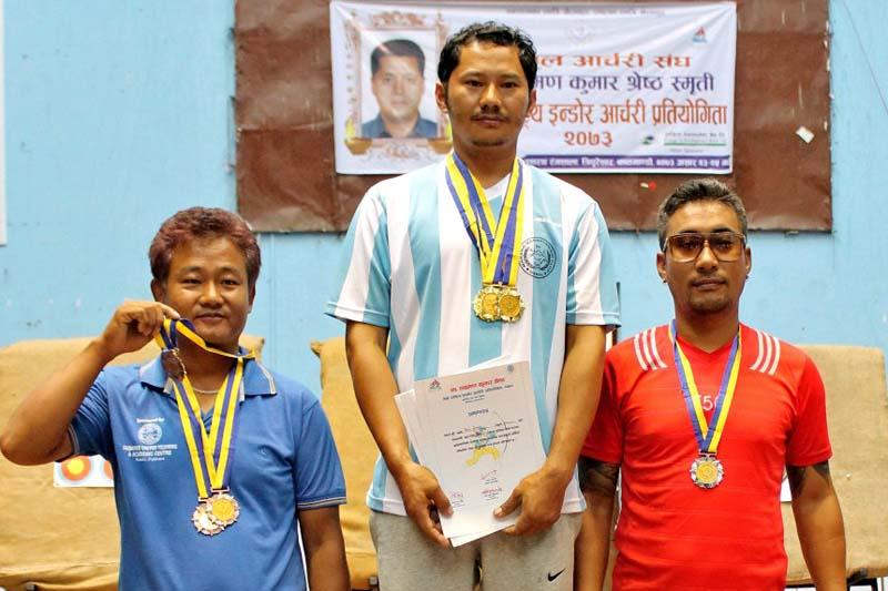Jit Bahadur Moktan (centre) poses with three gold medals after the third Laxman Kumar Shrestha Memorial National Indoor Archery Tournament in Kathmandu on Friday, July 8, 2016. Photo: THT