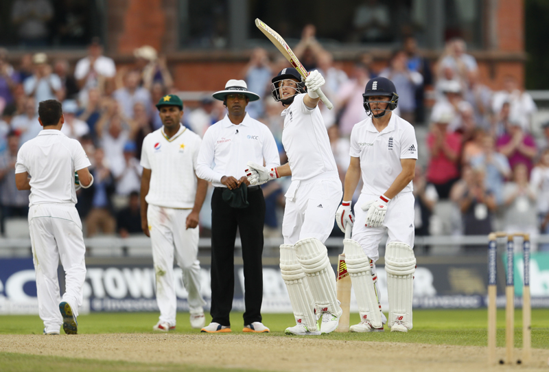 England's Joe Root celebrates his century. Photo: Reuters