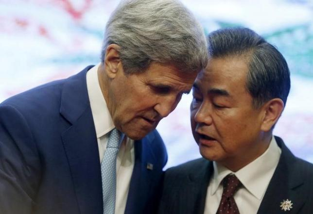 U.S. Secretary of State John Kerry and China's Foreign Minister Wang Yi talk at the 5th East Asia Summmit at the 48th Association of Southeast Asian Nations (ASEAN) foreign ministers meeting in Kuala Lumpur, Malaysia, August 6, 2015. REUTERS/Olivia Harris/File Photo