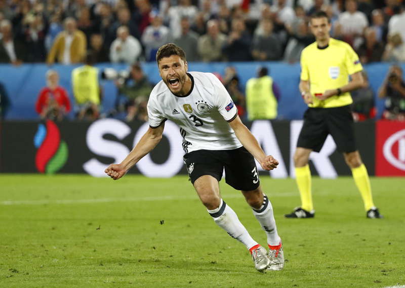 Germany's Jonas Hector celebrates scoring in the penalty shootoutn against Italy at Stade de Bordeaux, in Bordeaux on Saturday, July 2, 2016. Photo: Reuters