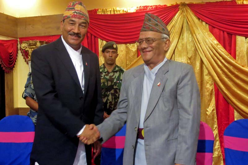 Rastriya Prajatantra Party-Nepal Chairman Kamal Thapa shakes hands with Rastriya Prajatantra Party Chairman Lokendra Bahadur Chand at an event organised to share their preparation for unification, in Kathmandu, on Monday, July 11, 2016. Photo: RSS