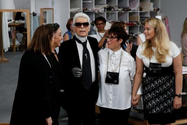 German designer Karl Lagerfeld appears at the end of his Haute Couture Fall Winter 2016/2017 fashion show for Chanel in Paris, France, July 5, 2016. REUTERS/Benoit Tessier
