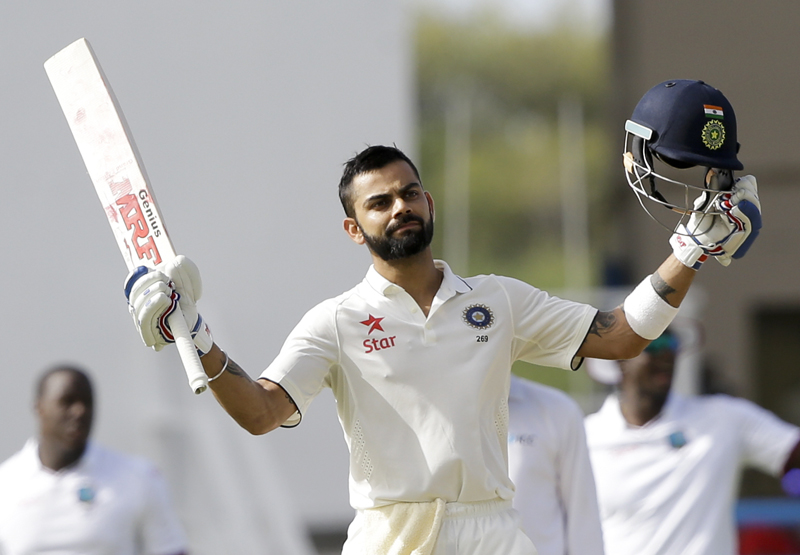 India's captain Virat Kohli celebrates after he scored a century during day one of thei first cricket Test match against West Indies at the Sir Vivian Richards Stadium in North Sound, Antigua, Thursday, July 21, 2016. Photo: AP