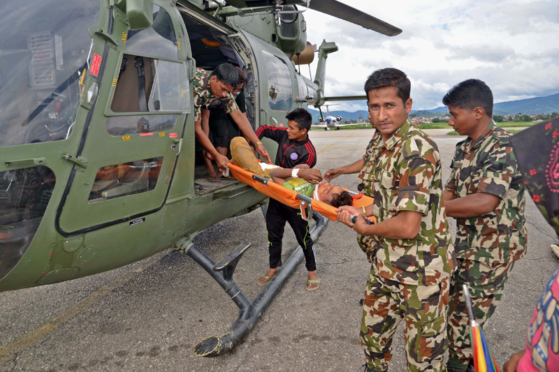 Landslide victim being debussed by the Nepali Army personnel in Kathmandu, on Tuesday, July 5, 2016. Photo: RSS