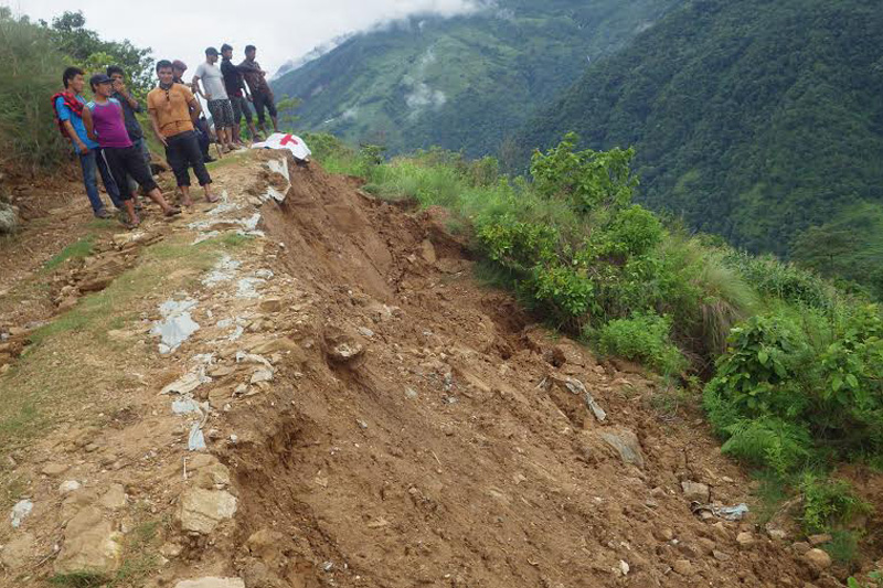 Locals of  Majhkot village in Lamjung district asses the situation after their village was hit by a landslide on Friday, July 1, 2016. Photo: Ramji Rana
