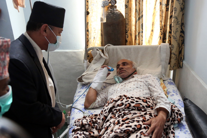 Chairperson of the Social Justice and Human Rights Committee of the Parliament, Sushil Kumar Shrestha, visits Dr Govinda KC, who is on a fast-unto-death, in Kathmandu, on Monday, July 18, 2016. Photo: RSS