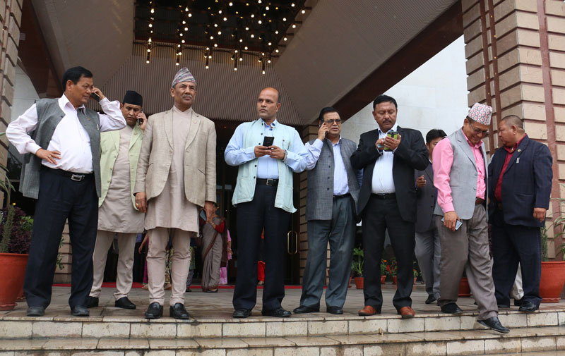 Lawmakers exit the Parliament building after a meeting scheduled for 11 am postponed for 2 pm in New Baneshwor on Thursday, July 21, 2016. Photo: RSS